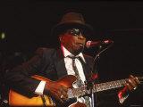 Blues Singer and Guitarist John Lee Hooker Performing
