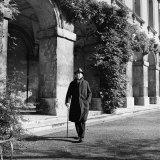 Scholar CS Lewis Walking with Cane Near Building at Magdalen College  Oxford University