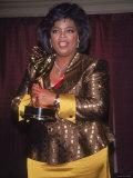 Talk Show Host Oprah Winfrey Holding Emmy Award