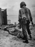 American Soldier Standing over Bodies of Japanese Attackers on Buna Beach
