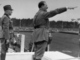 German Fuhrer Adolf Hitler Saluting as He Delivers Speech  Standing in Front of Heinrich Himmler