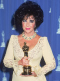 Elizabeth Taylor Holding Her Oscar in Press Room at Academy Awards