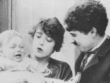 "Charlie Chaplin with Mabel Normand in ""His Trysting Place"""