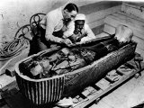 Archaeologist Howard Carter Examining Coffin of Tutankhamen  with 14th Century Egyptian Pharaoh