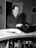 Movie Director Alfred Hitchcock Typing Script on a Portable Typewriter