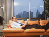 Fed Reserve Bd Chairman Appointee Alan Greenspan Stretched Out on Couch in His Apartment