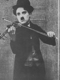 Charlie Chaplin as a Street Musician in The Vagabond