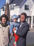 Presidential Candidate John F Kennedy Holding Daughter with Wife Outside Home on Election Day