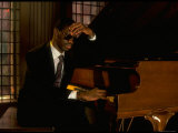 Jazz Pianist Marcus Roberts Seated at Piano in Henley Park Hotel