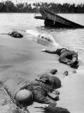 Bodies of American Soldiers Lying in Sand on Shoreline on Buna Beach After a Japanese Ambush Attack