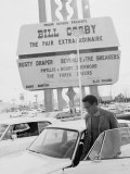 Comedian Bill Cosby Getting Into Car in Front of Sands Hotel Marquee with His Name on It