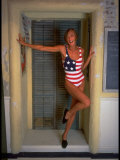Model Standing in Doorway Modeling Ralph Lauren's Cotton and Lycra One Piece Flag Bathing Suit