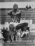Rafer Johnson in Decathlon Broad Jump in Olympics