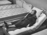 Woman Resting After a Long Siege of Bed Testing in the Bed Department at Lewis and Conger Store