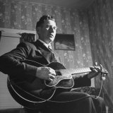 Considered Father of Country Western Music  AP Carter  Singing and Playing Guitar