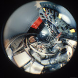 Fisheye View of Project Mercury Astronaut John Glenn in Mock Space Capsule  Location Unknown