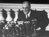 President Franklin D Roosevelt Sitting in Front of a Network Radio Microphones