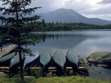 Canoes Turned Bottom Side Up on Shore of Unidentified Lake in Maine