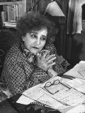 French Novelist Colette  at Desk Covered with Handwritten Notes Topped by Reading Glasses at Home
