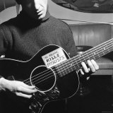 Folk Singer Woody Guthrie Playing Guitar with Sign on It Reading This Machine Kills Fascists