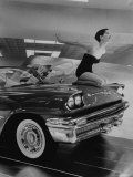 Model Jean Littleton in Swimsuit  Posing as Hood Ornament on the Front of a New de Soto Convertible