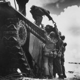 "Wounded American Marine Being Loaded Onto ""Alligator"" Tracked Amphibious Vehicle for Evacuation"