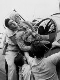 Crewman Lifting Injured Airman Kenneth Bratton Out of Turret of Tbf Aircraft on USS Saratoga