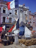 American Soldiers Standing Next to World War I Monument Bedecked with French Flags