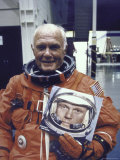 Astronaut John Glenn in Pressure Suit for Flight Into Space Holding Photo of Himself