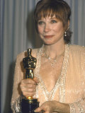 Shirley MacLaine Holding Her Oscar in Press Room at Academy Awards
