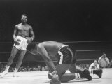 Cassius Clay Dancing Around Ring  Looking at Floyd Patterson  Whom He Has Just Knocked Down