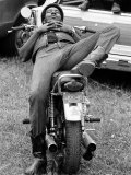 African American Man Relaxing on His Motocycle During Motorcycle Races near Detroit  Michigan