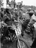 White Rider Preparing to Race at Mostly Black Motorcycle Enthusiasts