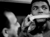 Heavyweight Contender Cassius Clay  Getting His Mouth Taped by Trainer Angelo Dundee