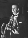 Movie Producer Walt Disney Holding Four Oscar Awards He Won