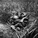 American Infantryman Terry Moore Taking Cover; Japanese Artillery Fire Explodes Nearby During