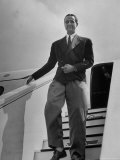 Millionaire Howard Hughes Deplaning at Airport