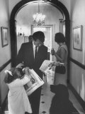 US Attorney General Bobby Kennedy Browsing Copy of the NY Times with daughter and Wife