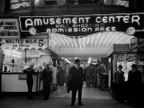 Sailors  Soldiers and Other Customers Standing Outside of Neon Lit Amusement Arcade