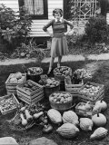 Woman Looking at Victory Garden Harvest Sitting on Lawn  Waiting to Be Stored Away for Winter