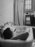 Writer Russell Finch Taking Portable Television Set to Bathroom During His Bath