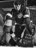Terry Sawchuck  Star Goalie for the Detroit Red Wings  Warding Off Shot on Goal  at Ice Arena