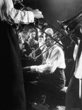 Composer Pianist Duke Ellington Playing Piano Amidst Two Trombonists during After Hours Jam Session
