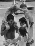 Children Playing with Their Fathers in the Swimming Pool
