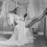 Movie Actress Carole Landis in Negligee as she Brushes Her Hair  Showing Off Gorgeous Legs