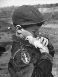 Boy with a Newly Hatched Chicken on a Farm in Maryland