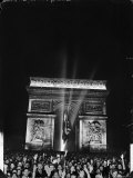 Crowd of Parisians under the Arc de Triomphe Celebrating the Liberation of the City