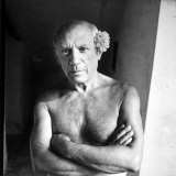 Pablo Picasso  Bare Chested and with Flower Tucked Behind Ear