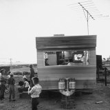 Railroad Construction Worker's Family Watching TV in Trailer at Camp for Southern Pacific Employees