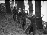 American Soldier Escorting a Group of German Prisoners Somewhere Along the Banks of the Roer River